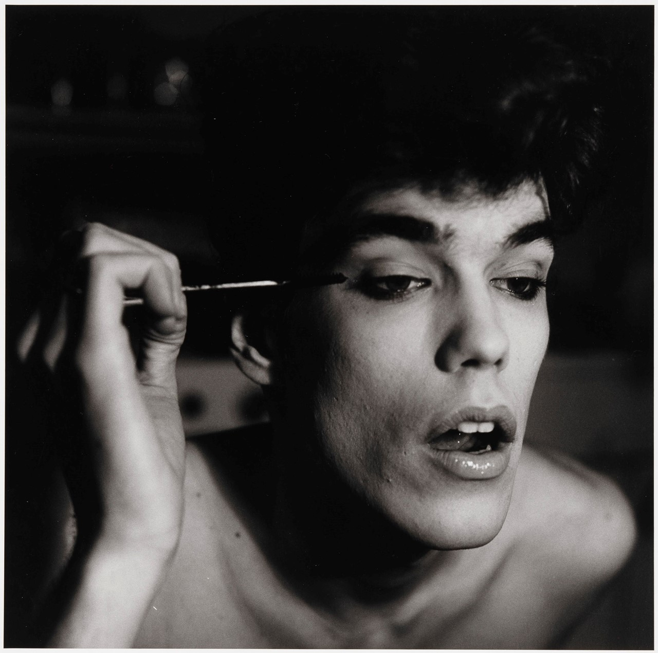 2. Peter Hujar, David Brintzenhofe Applying Makeup