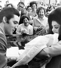 Elvis_Presley_and_Priscilla_with_Lisa_Marie_Februa